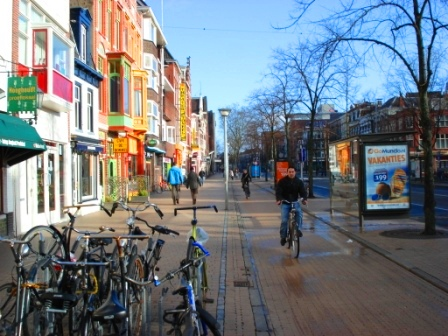 Bike path next to sidewalk and separated from road by a median in the city center of Groningen, Netherlands. Image Credit: Zachary Shahan / Bikocity
