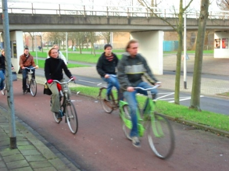 Bike paths separated from roadway by grassy area and also raised above the roadway in Groningen, Netherlands. Image Credit: Zachary Shahan / Bikocity